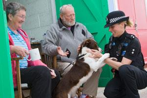 One of our female officers saying hello to a member of the public and stroking their dog.