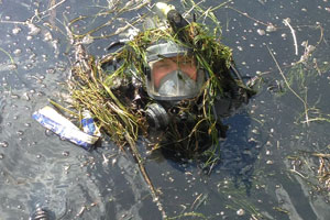 Devon & Cornwall Police Force diver's head merging from some murky river water