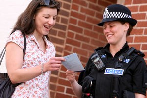 Female PC talking to a member of the public