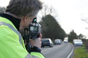 PSCO checking the speeds of vehicles