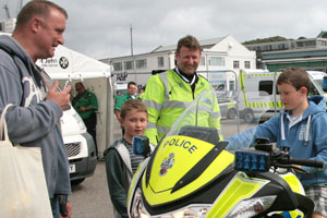 Police office with members of public, boy on motorbike