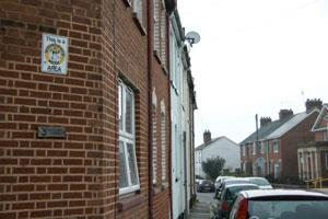 Neighbourhood watch sign on a town corner terraced house