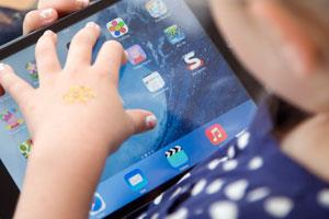 A small child using a tablet