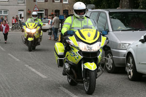 Two police officers riding motor bikes on a busy road