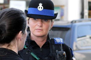 Female PCSO listening to member of public