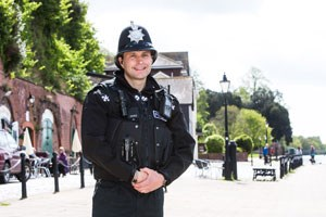 PC Robert Dodd standing on the key front in Exeter