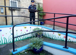 An officer sat in a refurbished garden