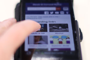 Mobile phone being used to look at a website