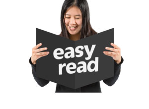 A person holding a card that reads easy read