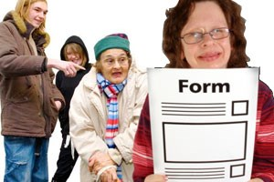 A group of people behind a lady holding a paper form