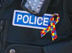 Detail of police uniform with autism awareness ribbon