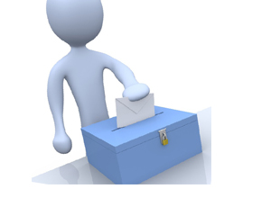 A person holding a piece of paper that they are putting into a voting box
