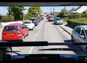 The view from a fire engines front window of traffic moving to the side of the road