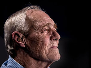 Elderly man hearing aid
