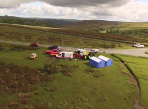 Operations unit set up on Dartmoor - blue marquees and partner vehicles