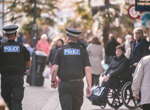 Officers walking down a high street
